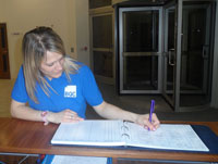 Hayley, Bristol Quality Cleaning team member, signing in for her shift.